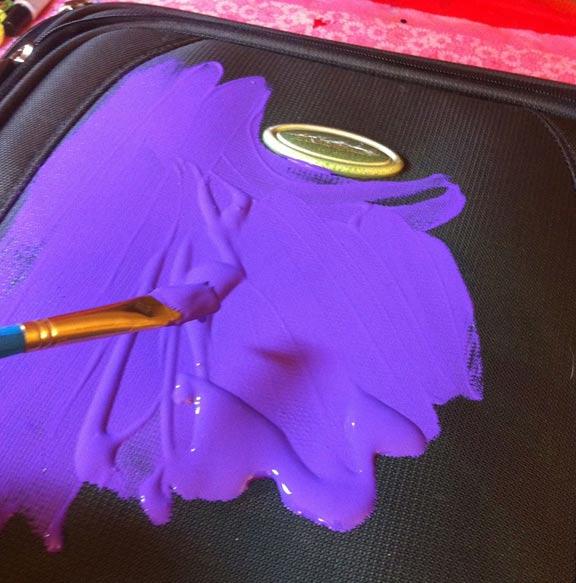 DIY glittered suitcase by Crafty Chica. #craftychica #glittercraft #paintedsuitcase