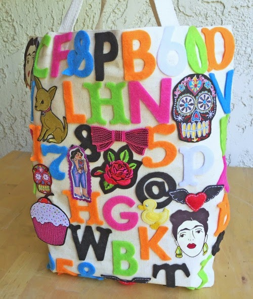 glue felt letters on a plain tote to liven it up! CraftyChica.com