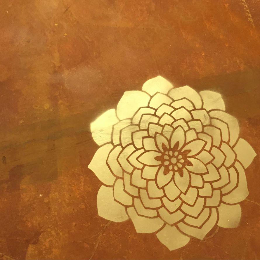 Use a stencil and gold spray paint to add a bright touch to your floor, by CraftyChica.com.